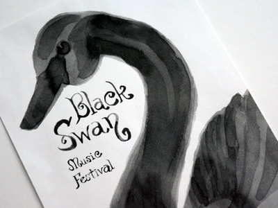 Photograph of a poster for the Black Swan Music Festival shows a left-facing black swan and the music festival title all done in a watercolor-like black ink wash.