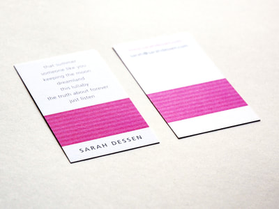 "Photograph of the front and back of a white, vertical business card with a bar of medium and dark pink stripes. ""Sarah Dessen"" is in an all-caps, sans serif font and her books and contact information are in lowercase."