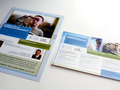 Conference materials for UNC-Chapel Hill's School of Law's Center for Civili Rights use Carolina blue and a soft, clear grass green. A photograph of a young African-American boy saluting is prominent, with a quote from Martin Luther King and conference information also pictured.