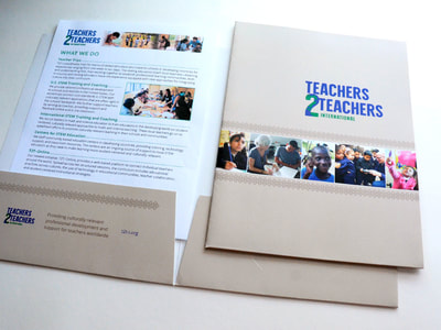 Photograph shows a taupe pocket folder open with a document inside, and with a closed folder on top. The folder has a photo collage bar and a green and blue Teachers 2 Teachers-International Logo.