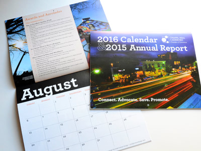 Photograph of the Chapel Hill-Carrboro Chamber of Commerce's 2016 calendar and 2015 annual report, showing a cover that features white text reversed out of a colorful nighttime photo of downtown; the August spread is also shown.