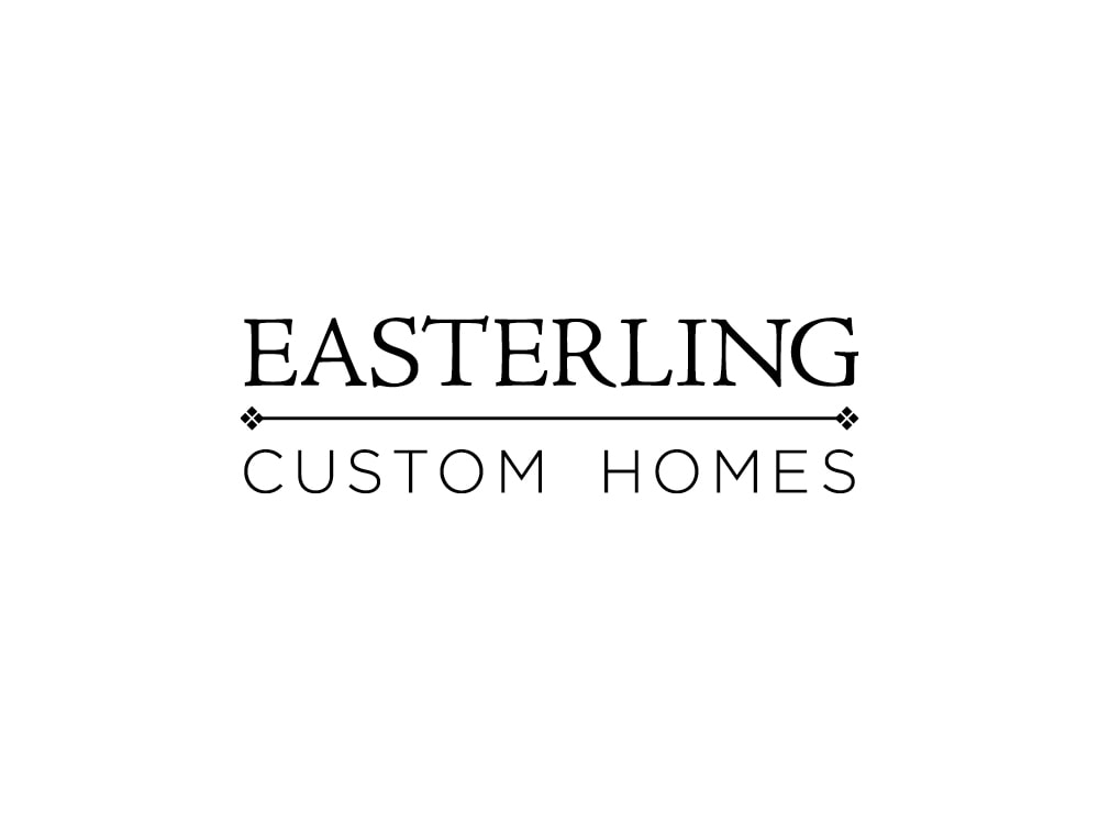 "This black logo has ""Easterling"" in all caps in an elegant serif font above ""Custom Homes"" in a smaller, sans serif, all caps font. A thin, horizontal line with diamond decorations on each end divides the two lines of words."