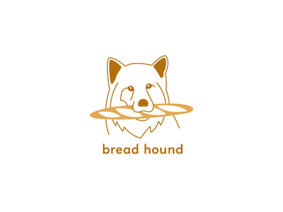 "This yellow and gold logo shows an outlined illustration of a dog with a fluffy ruff, holding a baguette in its mouth. The words ""bread hound"" are below in a lowercase sans serif font."