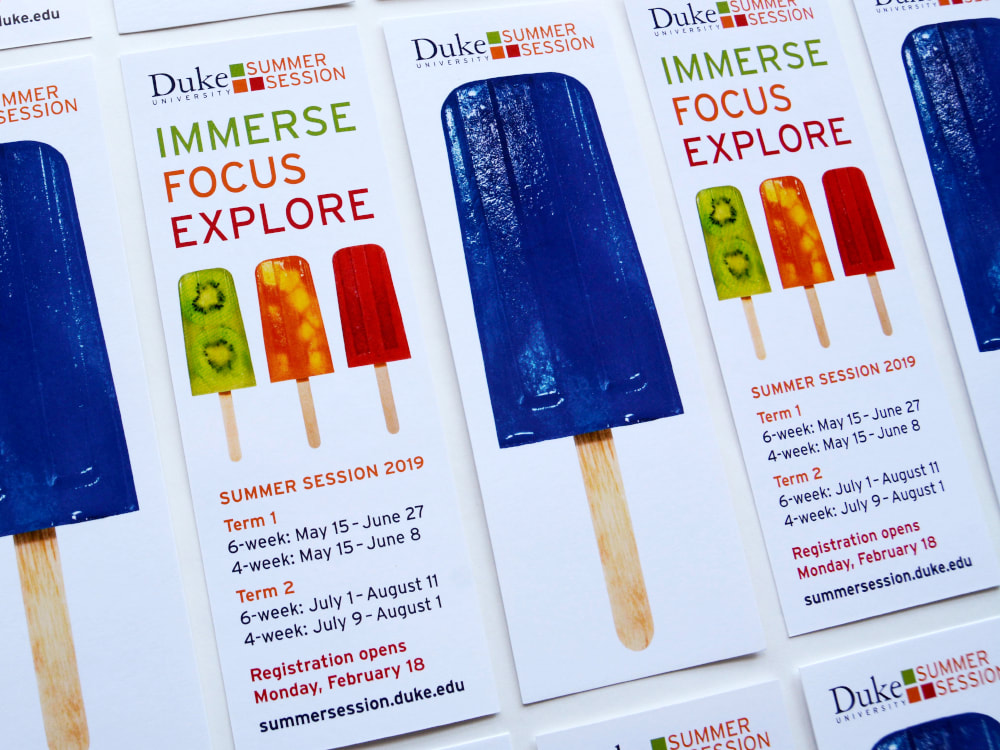 Bookmarks for Duke Summer Session have one Duke blue popsicle on one side and three smaller popsicles in kiwi, orange, and red on the back with information on class sessions.